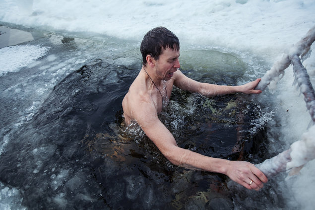 Man taking a swim in icy water